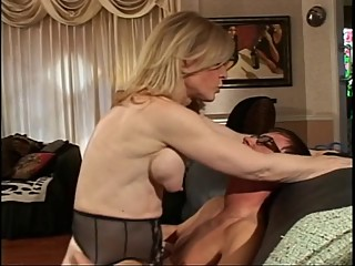 Blonde MILF strips for young dude who..